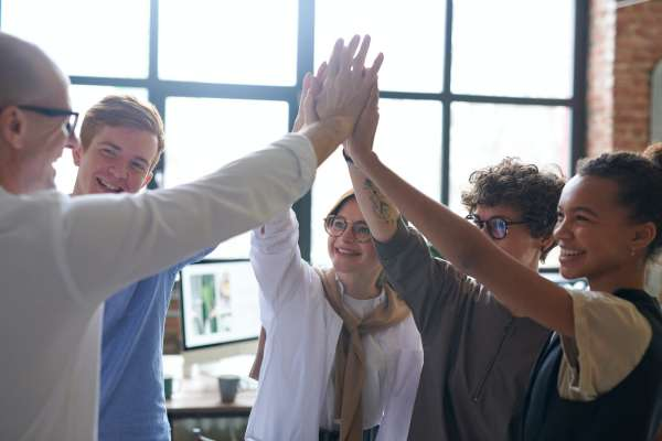 Diversity and Inclusion; group clapping hands together