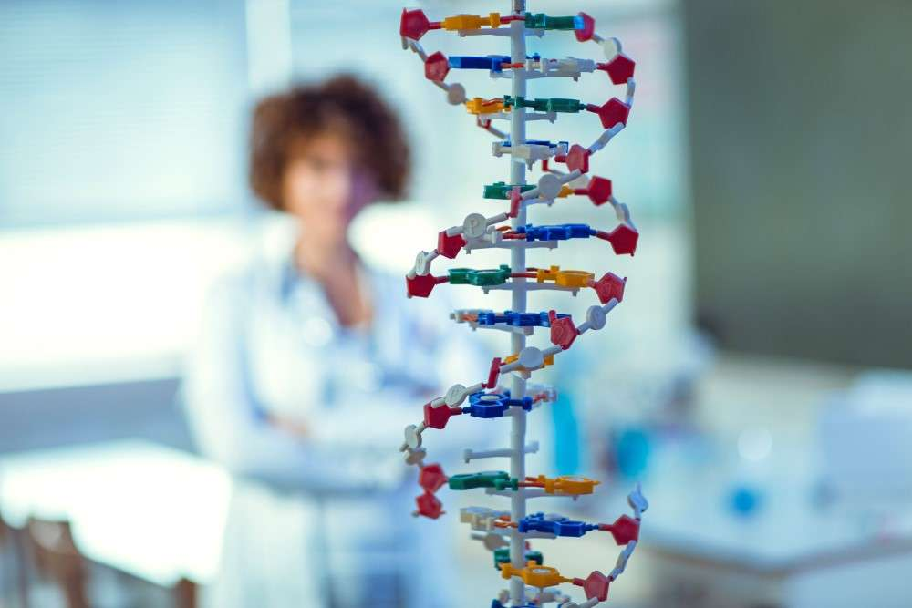 pharmacist in background with DNA Helix as the main point of the photo