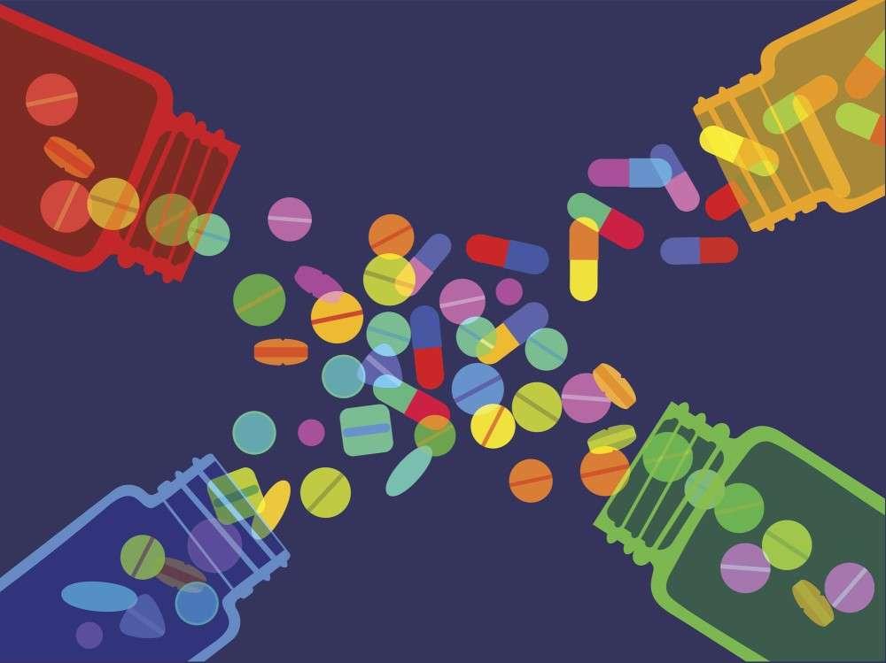 four pill bottles spilling pills