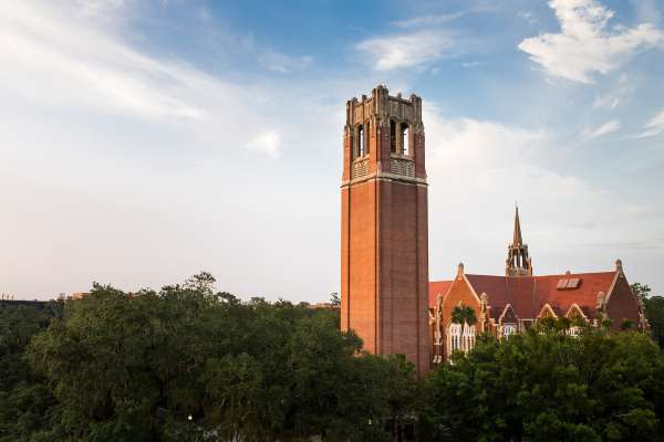 An evening view of UF's Century Tower and University Auditorium.